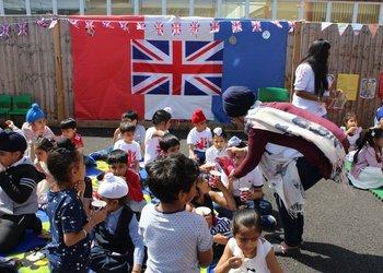 Children enjoying their Royal wedding party at the Atam Academy